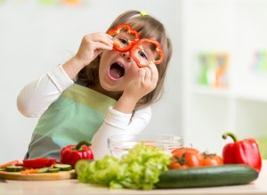 little-girl-playing-veggies